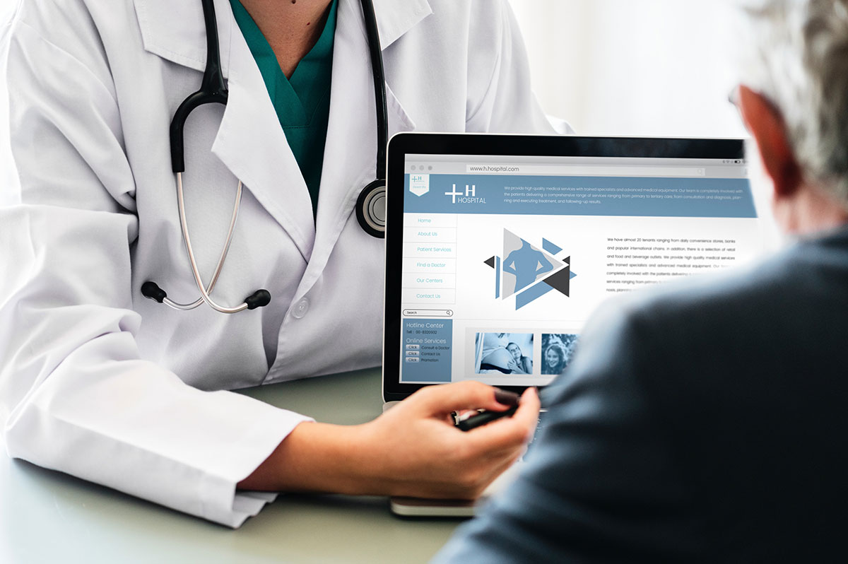 doctor showing laptop image to a person