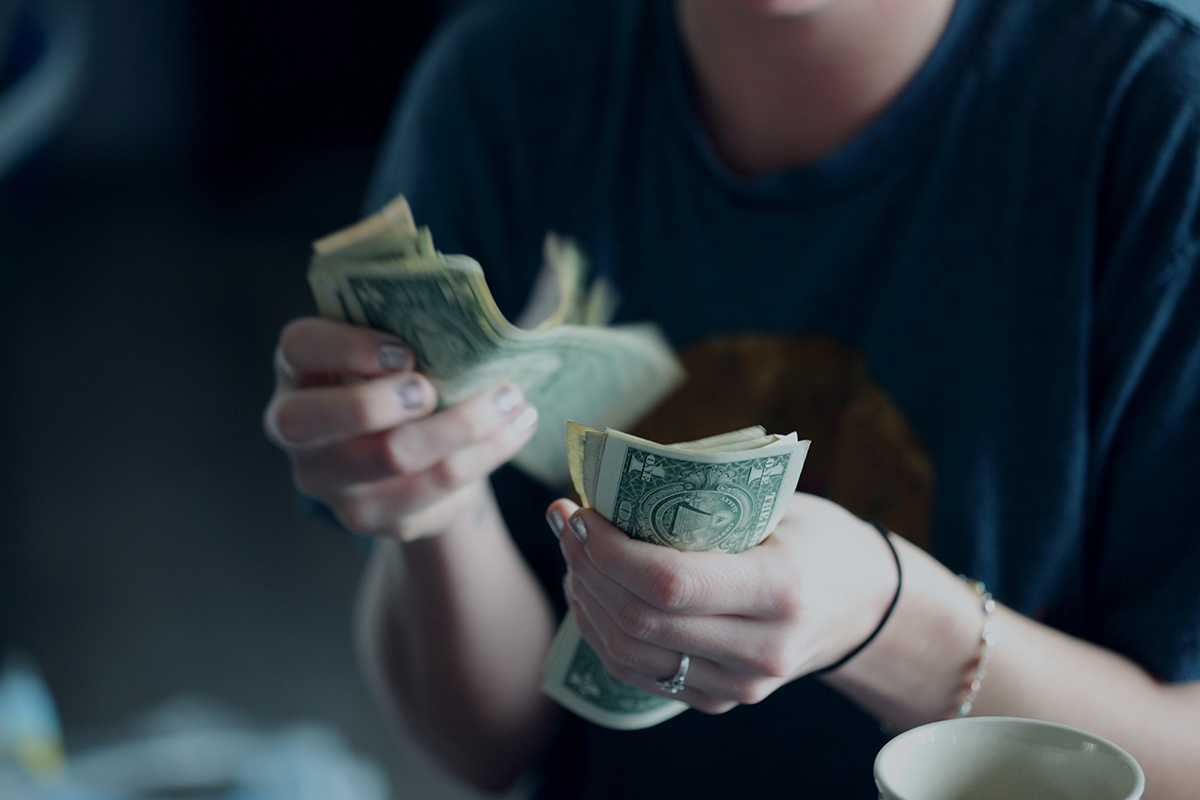 young woman counting money