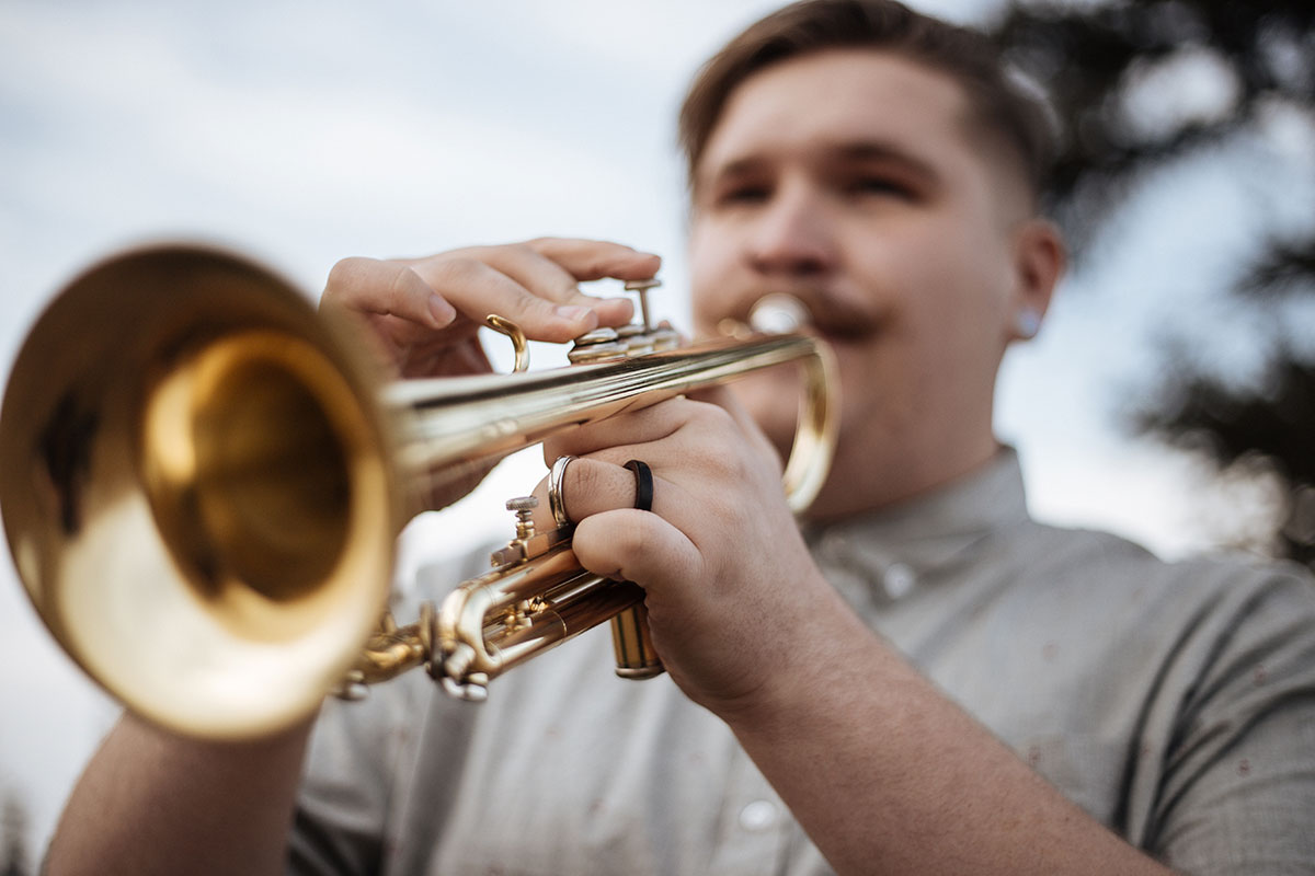 a man playing a trumpet
