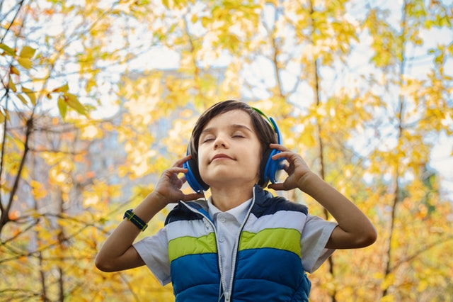 boy listening comfortably to music